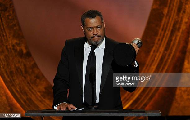 Actor Laurence Fishburne accepts the award for Outstanding Actor in a Television Movie Mini­Series or Dramatic Special for 'Thurgood' onstage at the...