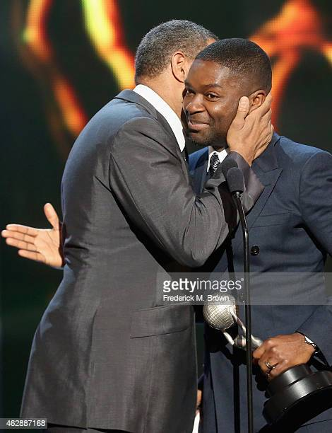 Actor Laurence Fishburne presents the award for Outstanding Actor in a Motion Picture for 'Selma' to actor David Oyelowo onstage during the 46th...
