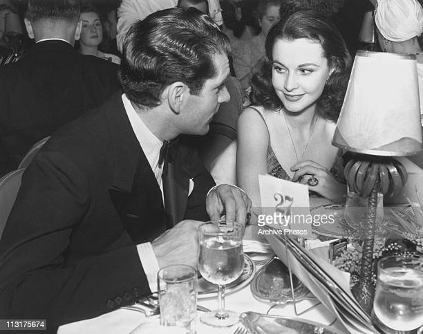 Actor Laurence Olivier and his wife actress Vivien Leigh at a dinner table in the 1940's