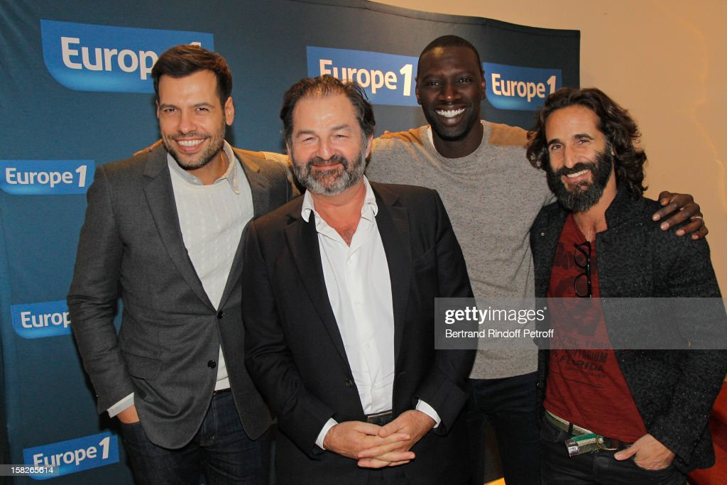 Actor Laurent Lafitte, Denis Olivennes, President of Lagardere Active and President of radio station Europe 1, actor <a gi-track='captionPersonalityLinkClicked' href=/galleries/search?phrase=Omar+Sy&family=editorial&specificpeople=4110364 ng-click='$event.stopPropagation()'>Omar Sy</a> and director David Charhon attend the private screening of the film 'De L'Autre Cote Du Periph' directed by Charhon, on December 11, 2012 in Paris, France.