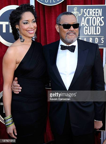 Actor Lawrence Fishburne and actress Gina Torres arrive at the 18th Annual Screen Actors Guild Awards at The Shrine Auditorium on January 29 2012 in...