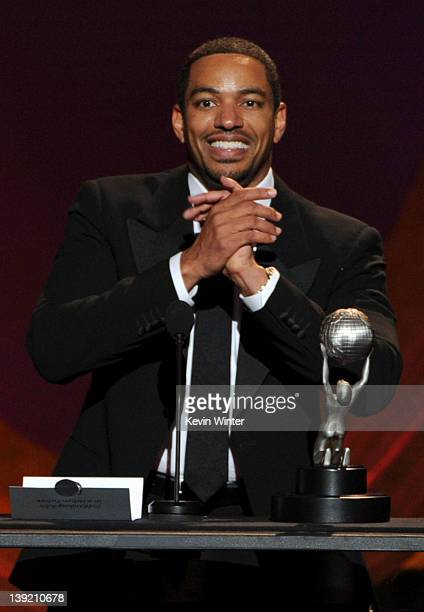 Actor Laz Alonzo accepts the award for Outstanding Actor in a Motion Picture for 'Jumping the Broom' onstage at the 43rd NAACP Image Awards held at...