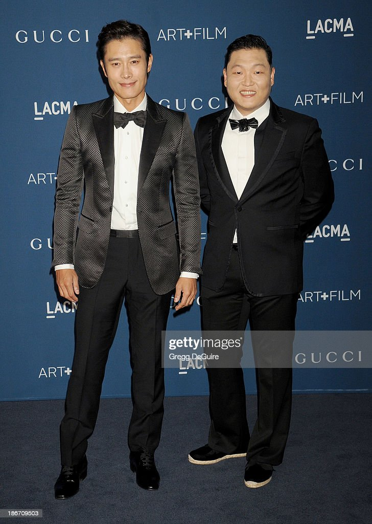 Actor Lee Byung-Hun and singer PSY arrive at the LACMA 2013 Art + Film Gala at LACMA on November 2, 2013 in Los Angeles, California.