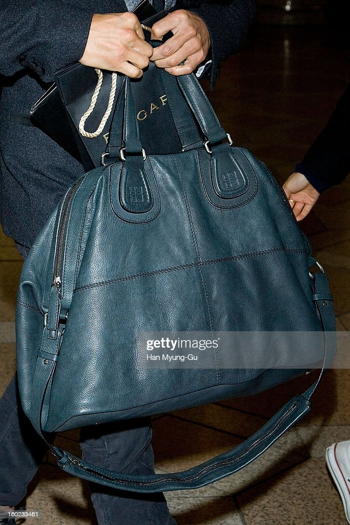 Actor Lee Byung-Hun (handbag detail) is seen at Gimpo International Airport on January 28, 2013 in Seoul, South Korea.