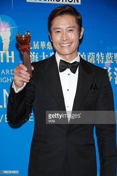 Actor Lee ByungHun poses backstage during 2013 Huading Awards Ceremony at Kowloonbay International Trade and Exhibition Centre on April 10 2013 in...