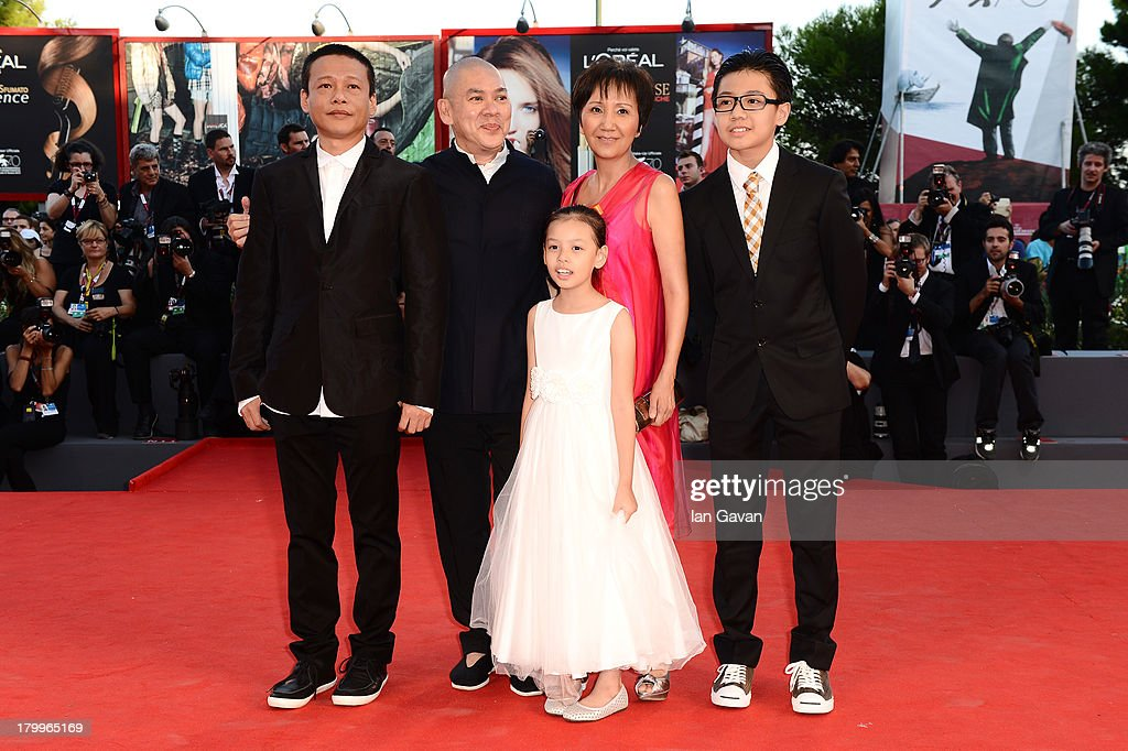 Actor Lee Kang-sheng, director Ming Liang Tsai and actors Lee Yi-cheng, Lu Yi-ching and Lee Yi-chieh (front) attend the Closing Ceremony during the 70th Venice International Film Festival at the Palazzo del Cinema on September 7, 2013 in Venice, Italy.
