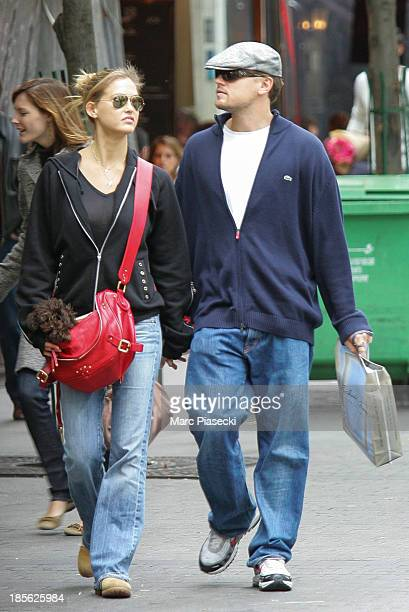 Actor Leonardo Di Caprio and girlfriend Bar Refaeli are seen strolling on 'Place du Marche SaintHonore' on October 21 2006 in Paris France