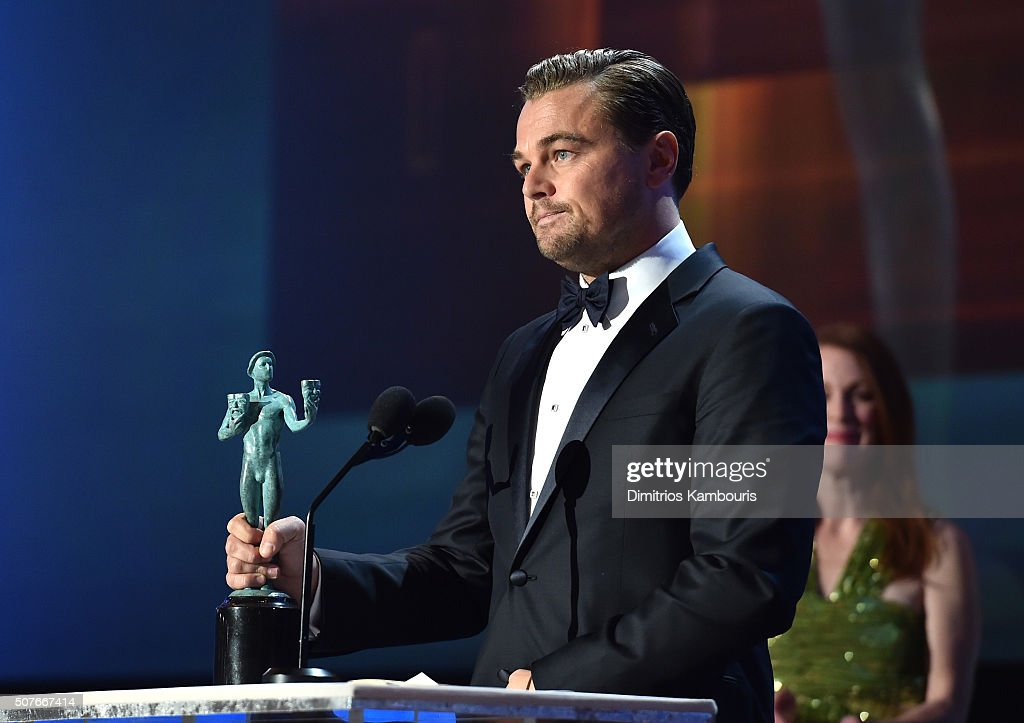 Actor Leonardo DiCaprio accepts the award for Outstanding Performance by a Male Actor in a Leading Role for 'The Revenant' onstage during The 22nd...