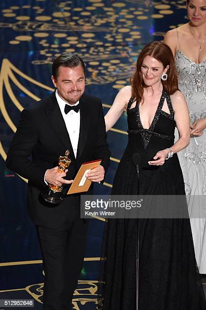 Actor Leonardo DiCaprio accepts the Best Actor award for 'The Revenant' from actress Julianne Moore onstage during the 88th Annual Academy Awards at...