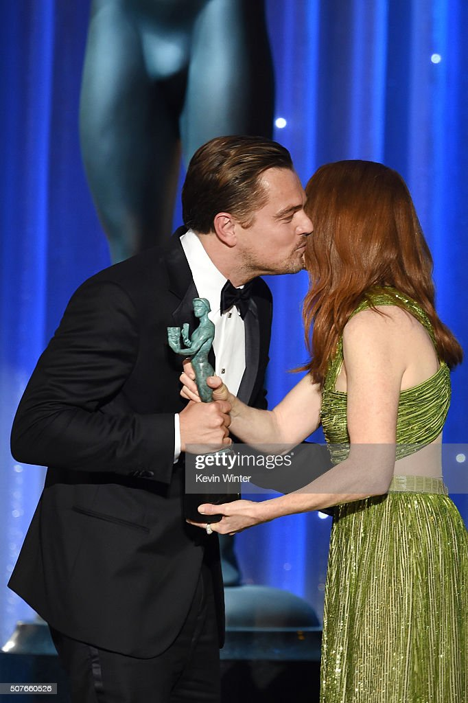 Actor Leonardo DiCaprio accepts the Male Actor in a Leading Role award for 'The Revenant' from actress Julianne Moore onstage during The 22nd Annual...