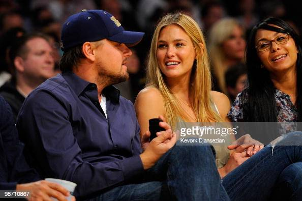 Actor Leonardo DiCaprio and girlfriend model Bar Refaeli sit courtside during Game Two of the Western Conference Quarterfinals of the 2010 NBA...