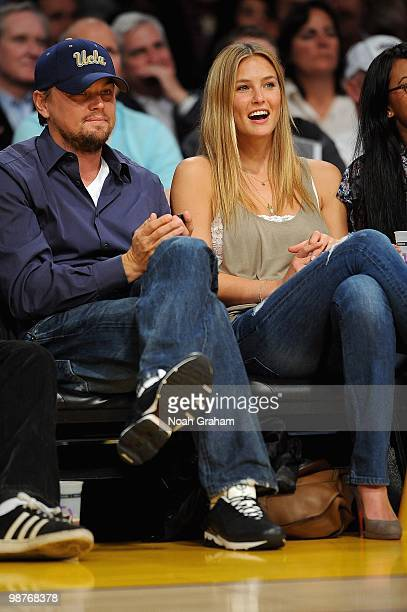 Actor Leonardo DiCaprio and model Bar Refaeli sit courtside during Game Five of the Western Conference Quarterfinals between the Oklahoma City...