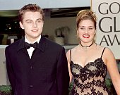 Actor Leonardo DiCaprio arrives with actress and Titanic costar Kate Winslet for the 55th Annual Golden Globe Awards at the Beverly Hilton 18 January...