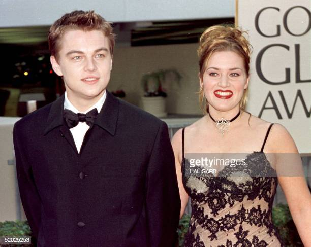 Actor Leonardo DiCaprio arrives with costar Kate Winslet for the 55th Annual Golden Globe Awards at the Beverly Hilton 18 January in Beverly Hills CA...