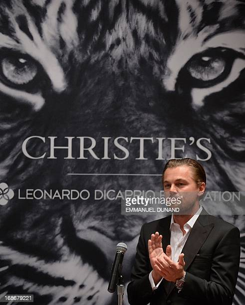 US actor Leonardo DiCaprio gives a speech at the start of the 11th Hour auction at Christie's in New York May 13 2013 The 11th Hour auction is...
