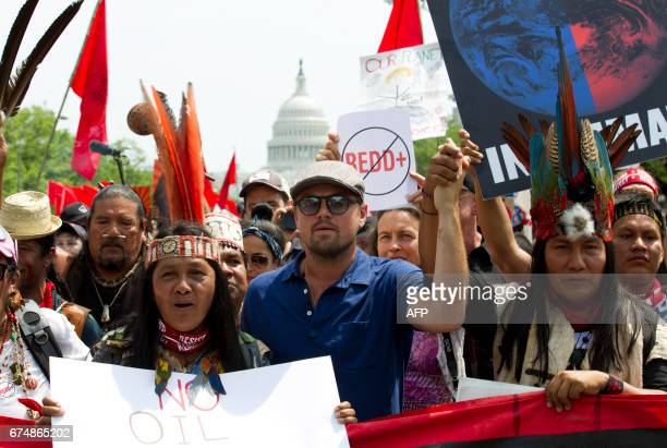 TOPSHOT US actor Leonardo DiCaprio marches with a group of indigenous people from North and South America during the People's Climate March in...