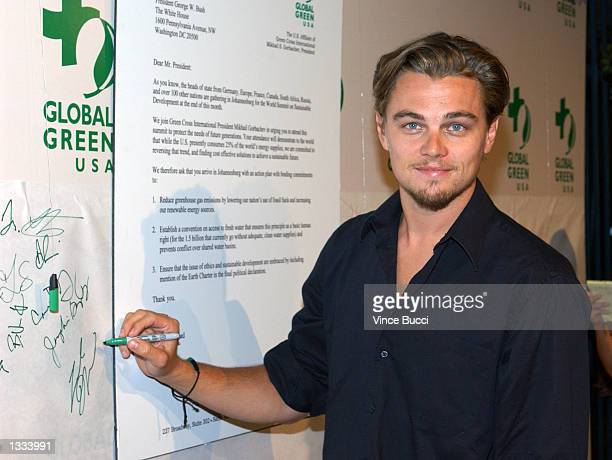 Actor Leonardo DiCaprio signs a letter to US President George Bush at the Rock The Earth Summit Party on August 12 2002 in Hollywood California The...