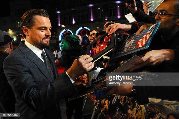 Actor Leonardo DiCaprio signs autographs as he attends the UK Premiere of The Wolf of Wall Street at London's Leicester Square on January 9 2014 in...