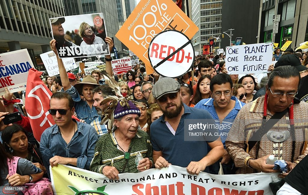 Actor Leonardo DiCaprio walks down 6th Avenue during the People's Climate March on September 21 in New York Activists mobilized in cities across the...