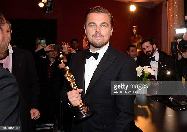Actor Leonardo DiCaprio winner of the Best Actor award for 'The Revenant' poses with his Oscar at the 88th Annual Academy Awards Governors Ball at...