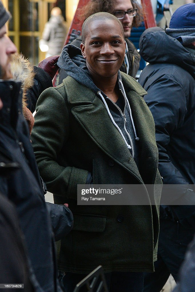 Actor Leslie Odom Jr. enters the 'Smash' movies poster at Times Square on February 4, 2013 in New York City