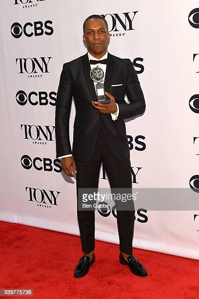 Actor Leslie Odom Jr poses in the press room with the award for Best Performance by an Actor in a Leading Role in a Musical at the 70th Annual Tony...