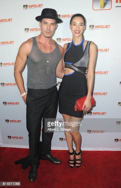Actor Lewis Tan and model Emi Renata attends Jeff Gund's INFOLISTcom's Annual PreComicCon Party held at OHM Nightclub on July 13 2017 in Hollywood...