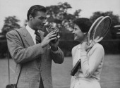 Actor Lex Barker filming tennis player Nancy Chaffee in anticipation of Wimbledon Tennis Tournament at the Hurlingham Club London June 23rd 1950