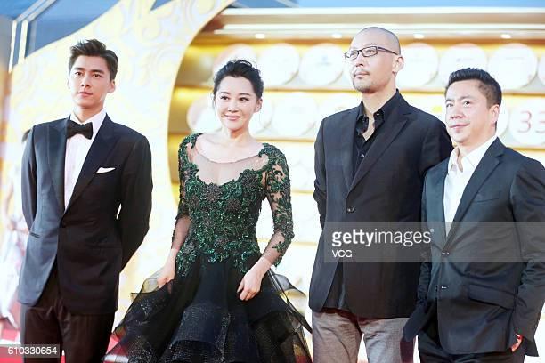 Actor Li Yifeng actress Xu Qing director Guan Hu and Huayi Brothers Media Corp CEO Wang Zhonglei arrive at the red carpet of the closing ceremony of...