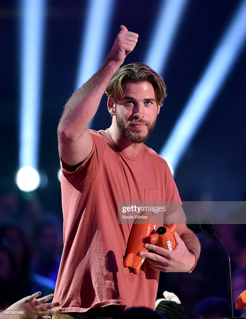Actor Liam Hemsworth accepts award for Favorite Male Action Star for The Hunger Games Mockingjay – Part 1 onstage during Nickelodeon's 28th Annual...