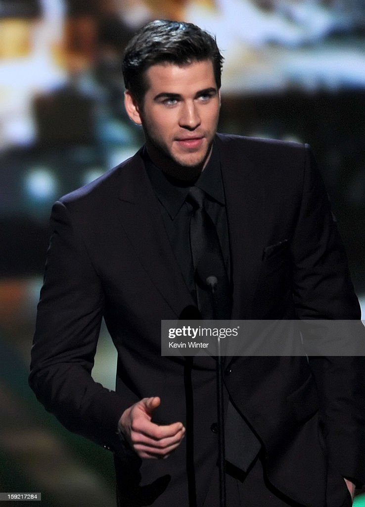 Actor Liam Hemsworth accepts Favorite Movie award for 'The Hunger Games' onstage at the 39th Annual People's Choice Awards at Nokia Theatre L.A. Live on January 9, 2013 in Los Angeles, California.