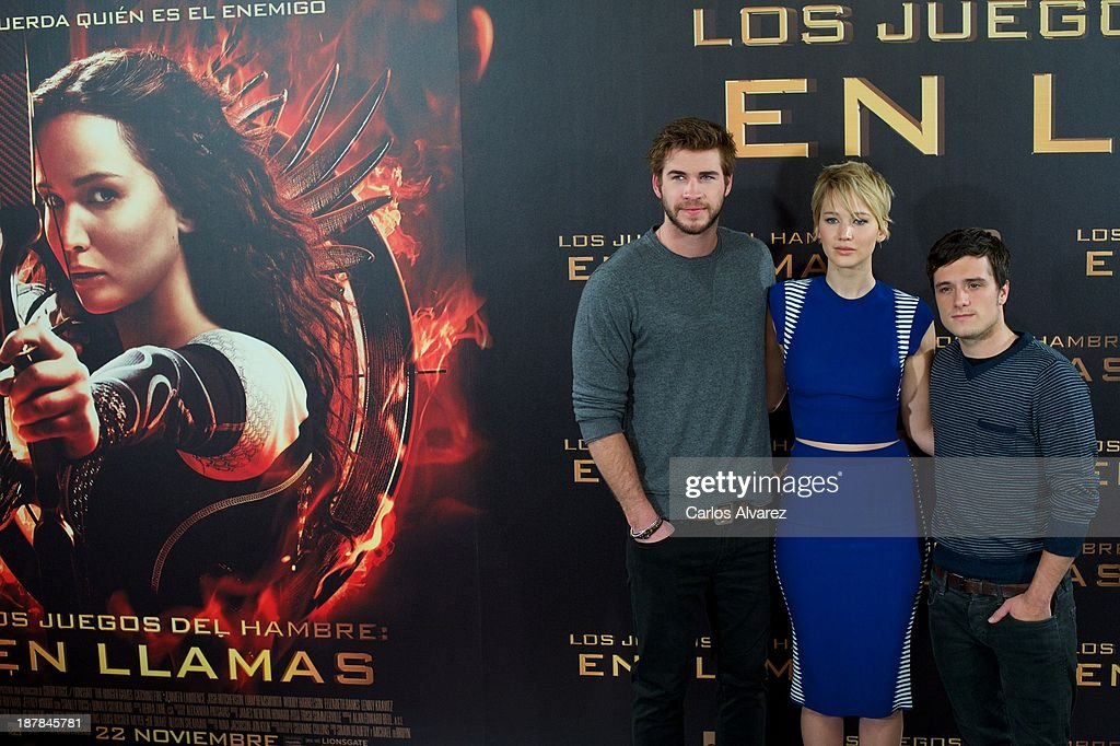 Actor <a gi-track='captionPersonalityLinkClicked' href=/galleries/search?phrase=Liam+Hemsworth&family=editorial&specificpeople=6338547 ng-click='$event.stopPropagation()'>Liam Hemsworth</a>, actress <a gi-track='captionPersonalityLinkClicked' href=/galleries/search?phrase=Jennifer+Lawrence&family=editorial&specificpeople=1596040 ng-click='$event.stopPropagation()'>Jennifer Lawrence</a> and actor <a gi-track='captionPersonalityLinkClicked' href=/galleries/search?phrase=Josh+Hutcherson&family=editorial&specificpeople=673588 ng-click='$event.stopPropagation()'>Josh Hutcherson</a> attend the Spanish photocall of the film 'The Hunger Games - Catching Fire' (Los Juegos Del Hambre: En Llamas) at the Villamagna Hotel on November 13, 2013 in Madrid, Spain.