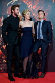 Actor Liam Hemsworth actress Jennifer Lawrence and actor Josh Hutcherson attend the Spanish premiere of the film 'The Hunger Games Catching Fire' at...