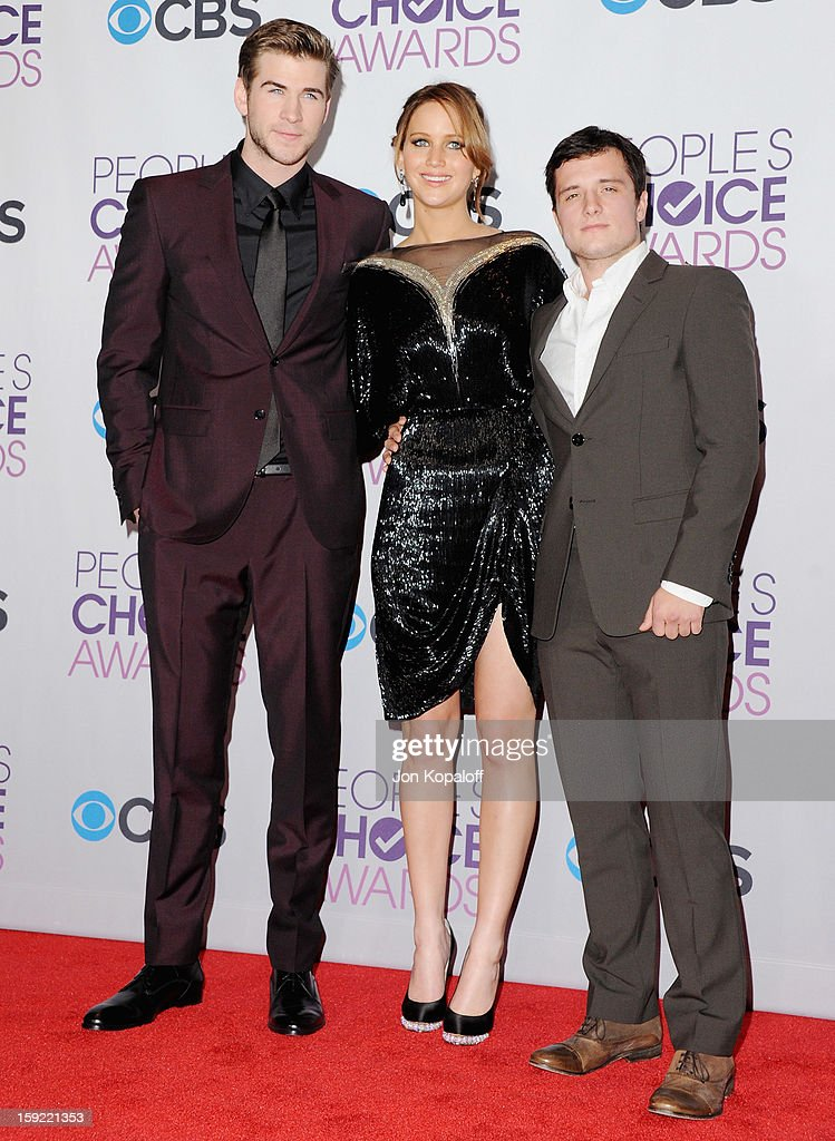 Actor Liam Hemsworth, actress Jennifer Lawrence and actor Josh Hutcherson pose in the pressroom at the 2013 People's Choice Awards at Nokia Theatre L.A. Live on January 9, 2013 in Los Angeles, California.