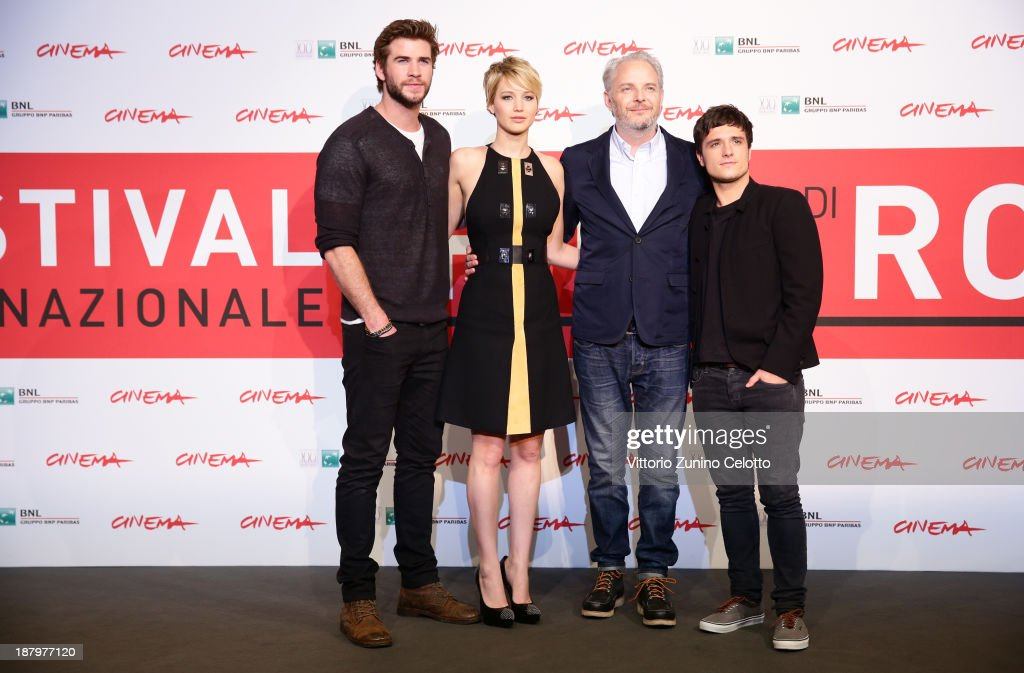 Actor <a gi-track='captionPersonalityLinkClicked' href=/galleries/search?phrase=Liam+Hemsworth&family=editorial&specificpeople=6338547 ng-click='$event.stopPropagation()'>Liam Hemsworth</a>, actress <a gi-track='captionPersonalityLinkClicked' href=/galleries/search?phrase=Jennifer+Lawrence&family=editorial&specificpeople=1596040 ng-click='$event.stopPropagation()'>Jennifer Lawrence</a>, director <a gi-track='captionPersonalityLinkClicked' href=/galleries/search?phrase=Francis+Lawrence&family=editorial&specificpeople=224820 ng-click='$event.stopPropagation()'>Francis Lawrence</a> and actor <a gi-track='captionPersonalityLinkClicked' href=/galleries/search?phrase=Josh+Hutcherson&family=editorial&specificpeople=673588 ng-click='$event.stopPropagation()'>Josh Hutcherson</a> attend the 'The Hunger Games: Catching Fire' Photocall during the 8th Rome Film Festival at the Auditorium Parco Della Musica on November 14, 2013 in Rome, Italy.