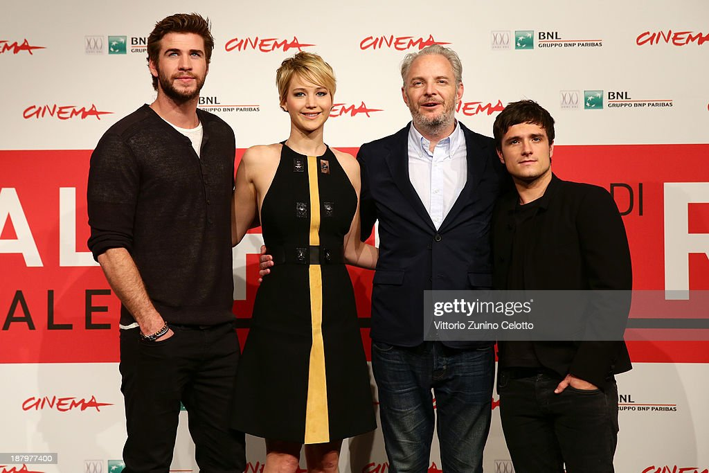 Actor Liam Hemsworth, actress Jennifer Lawrence, director Francis Lawrence and actor Josh Hutcherson attend the 'The Hunger Games: Catching Fire' Photocall during the 8th Rome Film Festival at the Auditorium Parco Della Musica on November 14, 2013 in Rome, Italy.