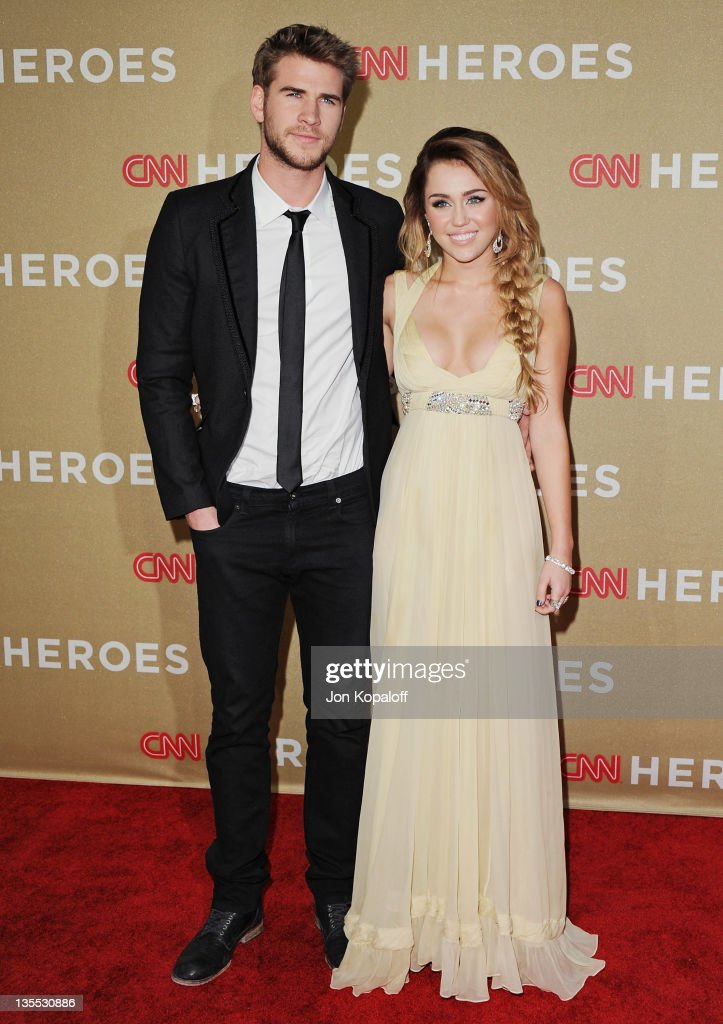 Actor <a gi-track='captionPersonalityLinkClicked' href=/galleries/search?phrase=Liam+Hemsworth&family=editorial&specificpeople=6338547 ng-click='$event.stopPropagation()'>Liam Hemsworth</a> and actress <a gi-track='captionPersonalityLinkClicked' href=/galleries/search?phrase=Miley+Cyrus&family=editorial&specificpeople=3973523 ng-click='$event.stopPropagation()'>Miley Cyrus</a> arrive at the 2011 CNN Heroes: An All-Star Tribute at The Shrine Auditorium on December 11, 2011 in Los Angeles, California.