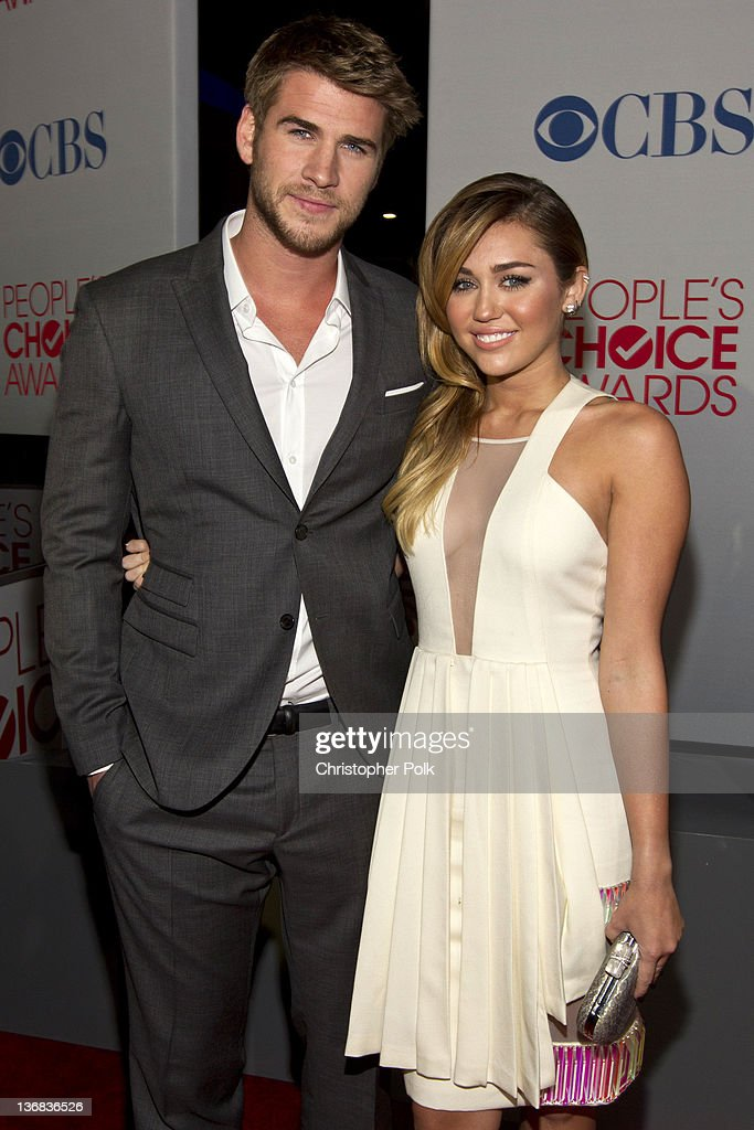 Actor Liam Hemsworth and Actress <a gi-track='captionPersonalityLinkClicked' href=/galleries/search?phrase=Miley+Cyrus&family=editorial&specificpeople=3973523 ng-click='$event.stopPropagation()'>Miley Cyrus</a> attends People's Choice Awards 2012 at Nokia Theatre LA Live on January 11, 2012 in Los Angeles, California.
