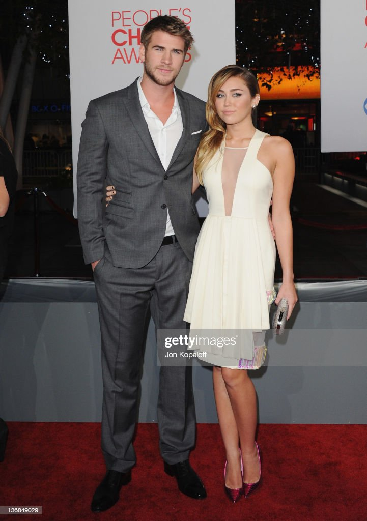 Actor <a gi-track='captionPersonalityLinkClicked' href=/galleries/search?phrase=Liam+Hemsworth&family=editorial&specificpeople=6338547 ng-click='$event.stopPropagation()'>Liam Hemsworth</a> and actress/recording artist <a gi-track='captionPersonalityLinkClicked' href=/galleries/search?phrase=Miley+Cyrus&family=editorial&specificpeople=3973523 ng-click='$event.stopPropagation()'>Miley Cyrus</a> arrive at the 2012 People's Choice Awards at Nokia Theatre L.A. Live on January 11, 2012 in Los Angeles, California.
