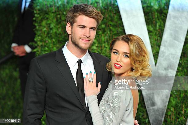 Actor Liam Hemsworth and actress/singer Miley Cyrus arrive at the 2012 Vanity Fair Oscar Party hosted by Graydon Carter at Sunset Tower on February...