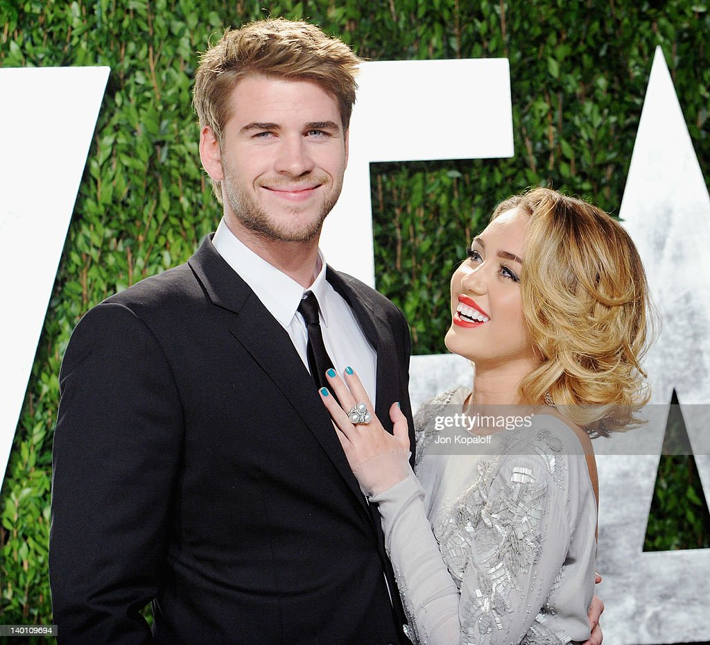 Actor Liam Hemsworth and actress/singer Miley Cyrus arrive at the 2012 Vanity Fair Oscar Party at Sunset Tower on February 26, 2012 in West Hollywood, California.