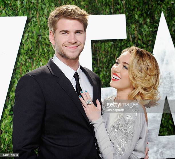 Actor Liam Hemsworth and actress/singer Miley Cyrus arrive at the 2012 Vanity Fair Oscar Party at Sunset Tower on February 26 2012 in West Hollywood...