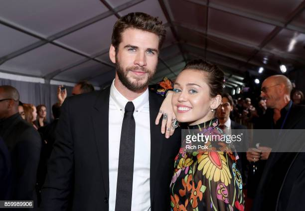 Actor Liam Hemsworth and Miley Cyrus at The World Premiere of Marvel Studios' 'Thor Ragnarok' at the El Capitan Theatre on October 10 2017 in...