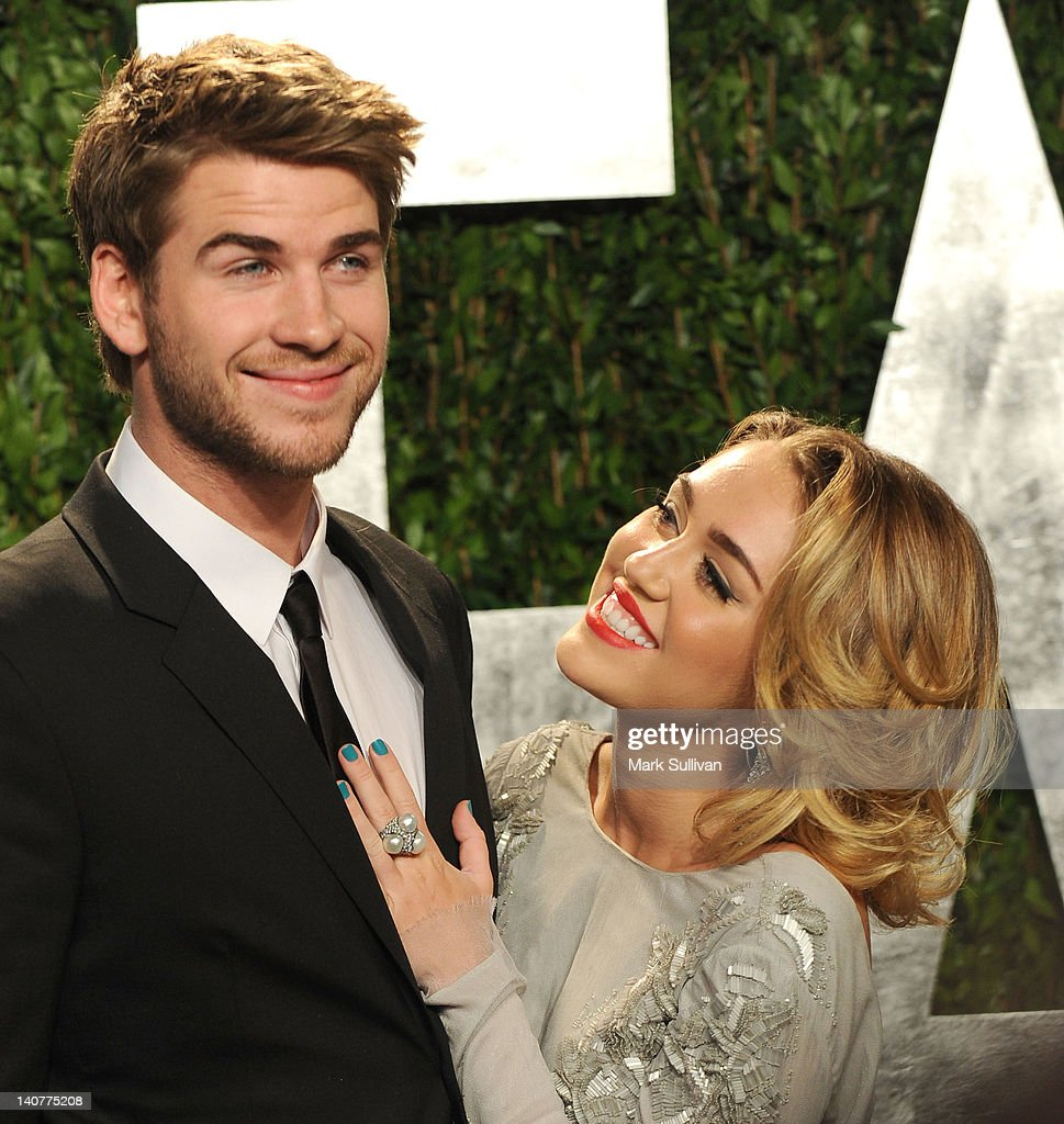 Actor Liam Hemsworth and singer Miley Cyrus arrive at the 2012 Vanity Fair Oscar Party hosted by Graydon Carter at Sunset Tower on February 26, 2012 in West Hollywood, California.