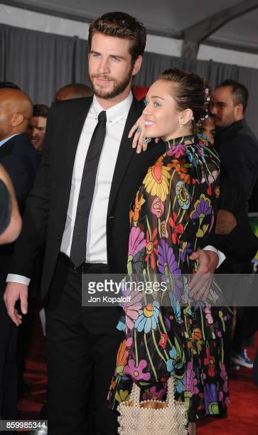 Actor Liam Hemsworth and singer Miley Cyrus arrive at the Los Angeles Premiere 'Thor Ragnarok' on October 10 2017 in Hollywood California