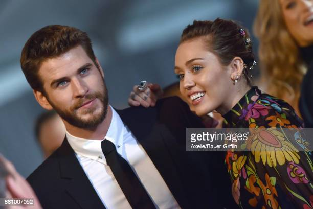 Actor Liam Hemsworth and singer Miley Cyrus arrive at the premiere of Disney and Marvel's 'Thor Ragnarok' at the El Capitan Theatre on October 10...