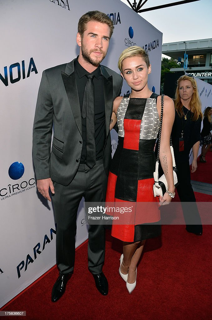 Actor <a gi-track='captionPersonalityLinkClicked' href=/galleries/search?phrase=Liam+Hemsworth&family=editorial&specificpeople=6338547 ng-click='$event.stopPropagation()'>Liam Hemsworth</a> and singer <a gi-track='captionPersonalityLinkClicked' href=/galleries/search?phrase=Miley+Cyrus&family=editorial&specificpeople=3973523 ng-click='$event.stopPropagation()'>Miley Cyrus</a> attend the premiere of Relativity Media's 'Paranoia' at DGA Theater on August 8, 2013 in Los Angeles, California.