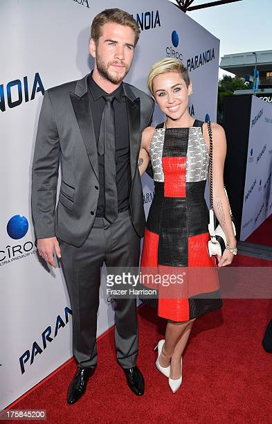 Actor Liam Hemsworth and singer Miley Cyrus attend the premiere of Relativity Media's 'Paranoia' at DGA Theater on August 8 2013 in Los Angeles...