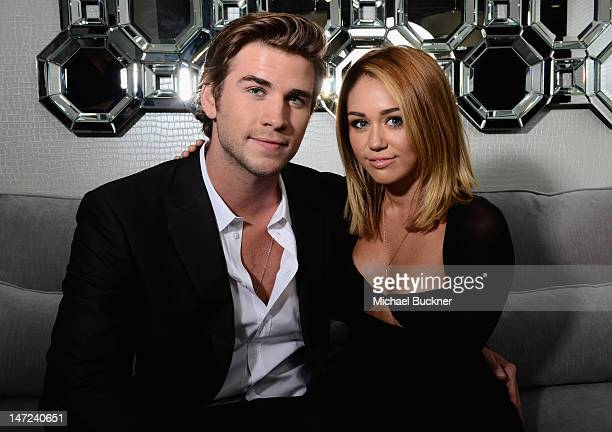 Actor Liam Hemsworth and singer Miley Cyrus pose during Australians In Film Awards Benefit Dinner at InterContinental Hotel on June 27 2012 in...