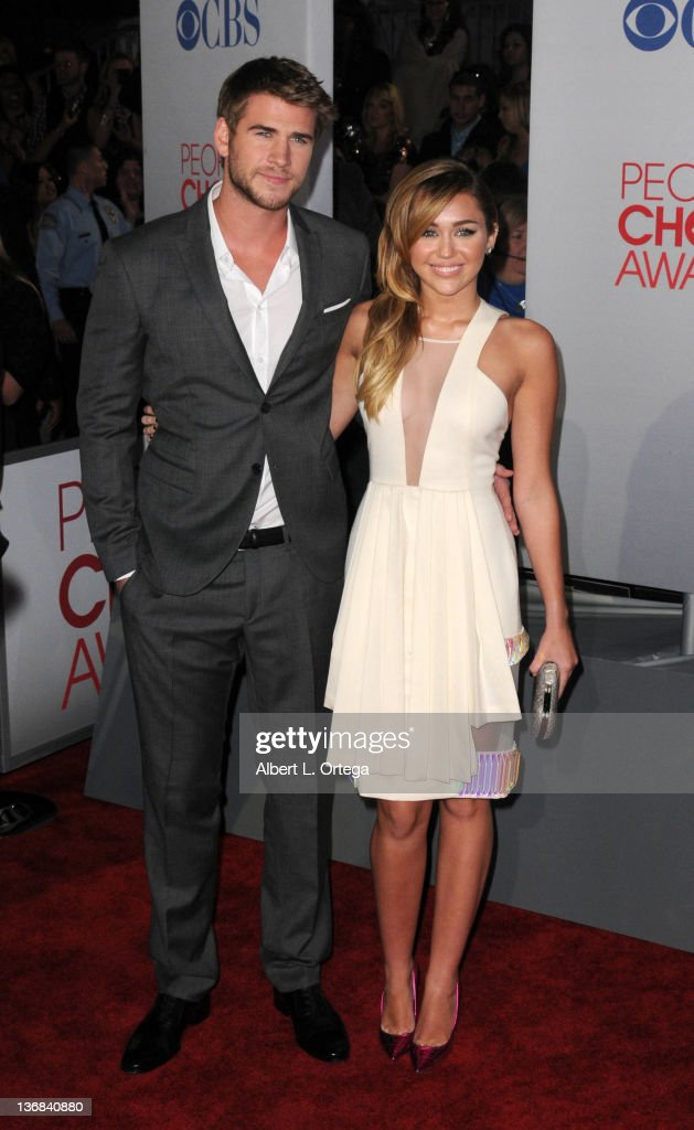 Actor <a gi-track='captionPersonalityLinkClicked' href=/galleries/search?phrase=Liam+Hemsworth&family=editorial&specificpeople=6338547 ng-click='$event.stopPropagation()'>Liam Hemsworth</a> and singer/actress <a gi-track='captionPersonalityLinkClicked' href=/galleries/search?phrase=Miley+Cyrus&family=editorial&specificpeople=3973523 ng-click='$event.stopPropagation()'>Miley Cyrus</a> arrive for the 2012 People's Choice Awards held at Nokia Theatre L.A. Live on January 11, 2012 in Los Angeles, California.